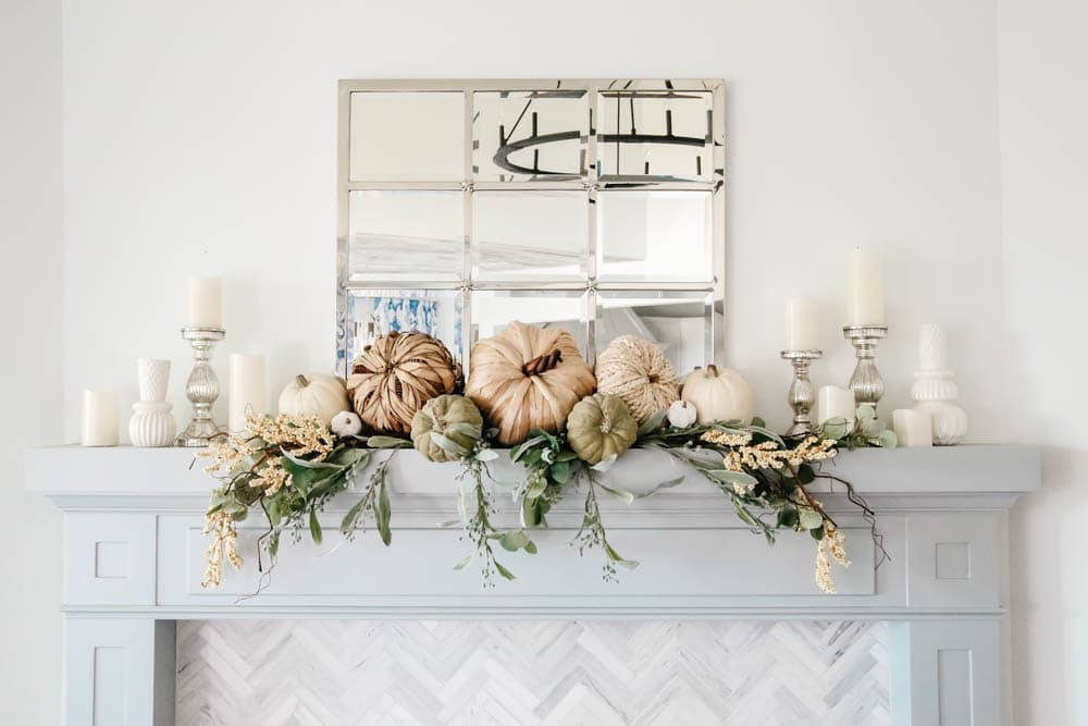 Fireplace mantle decorated for fall. Natural pumpkins, neutral fall decor ideas for the living room. #ABlissfulNest #falldecor #falldecoratingideas #livingroomideas #fireplacemantle