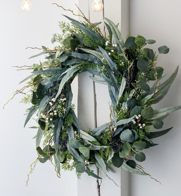 This eucalyptus wreath is the perfect fall and winter decor for your door. #ABlissfulNest