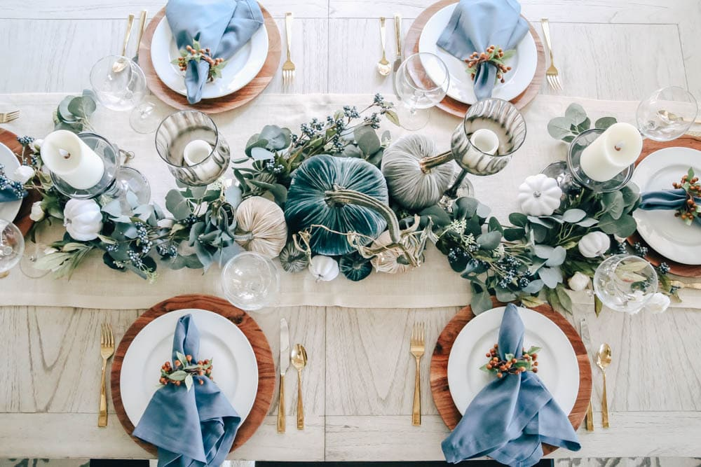 Pops of blue in napkins, pumpkins and berries create a beautiful layered look in this fall table. #ABlissfulNest #fall #thanksgiving #falldecor