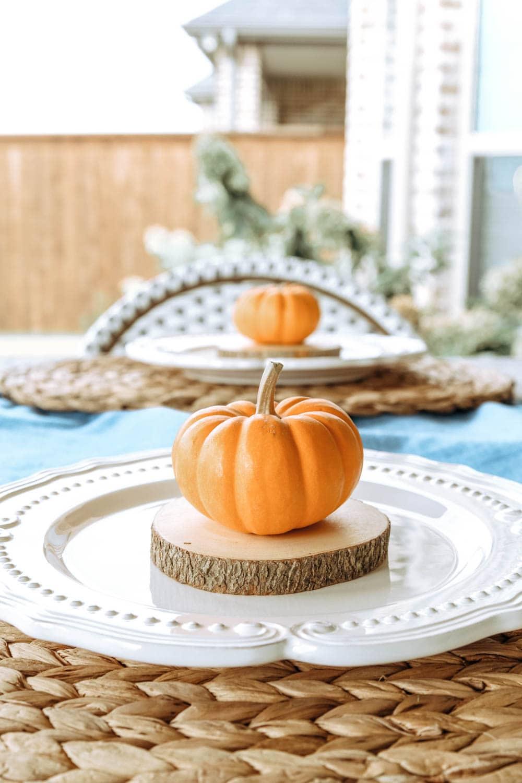 Mini pumpkins, white plates, wood accents. #ABlissfulNest #falldecor #falltable #thanksgiving