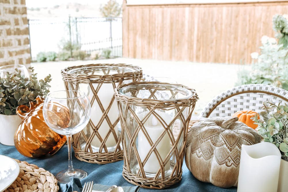 Beautiful basket weave hurricane vases, candles and pumpkins. Create gorgeous ambience for a fall table. #ABlissfulNest #falltable #fallinspiration #falldecor