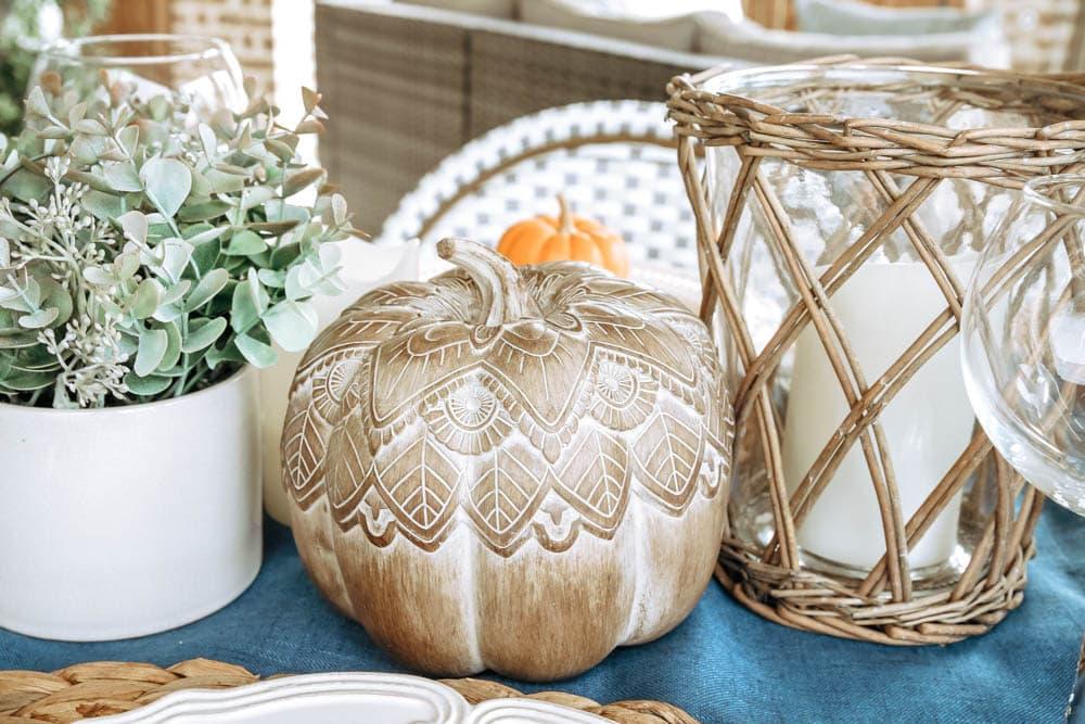 Carved wood pumpkin, fall table decorating ideas. #ABlissfulNest #fall #falldecor
