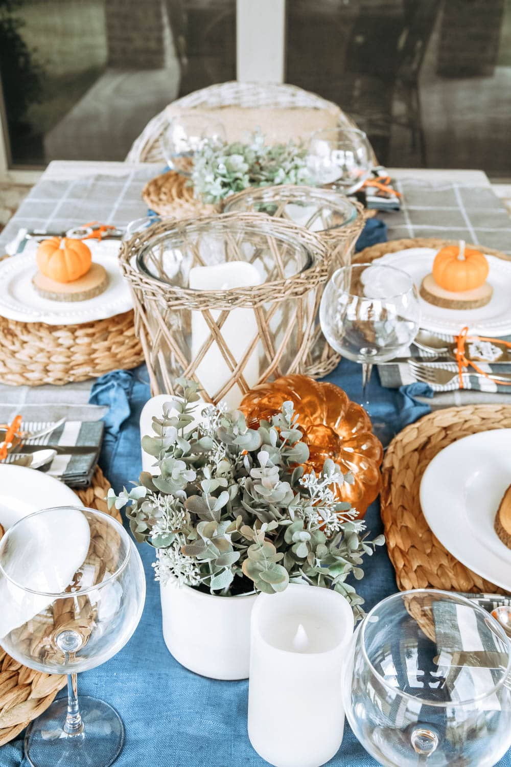 Add lots of candles to an outside fall table for ambience. #ABlissfulNest #fall #falldecor
