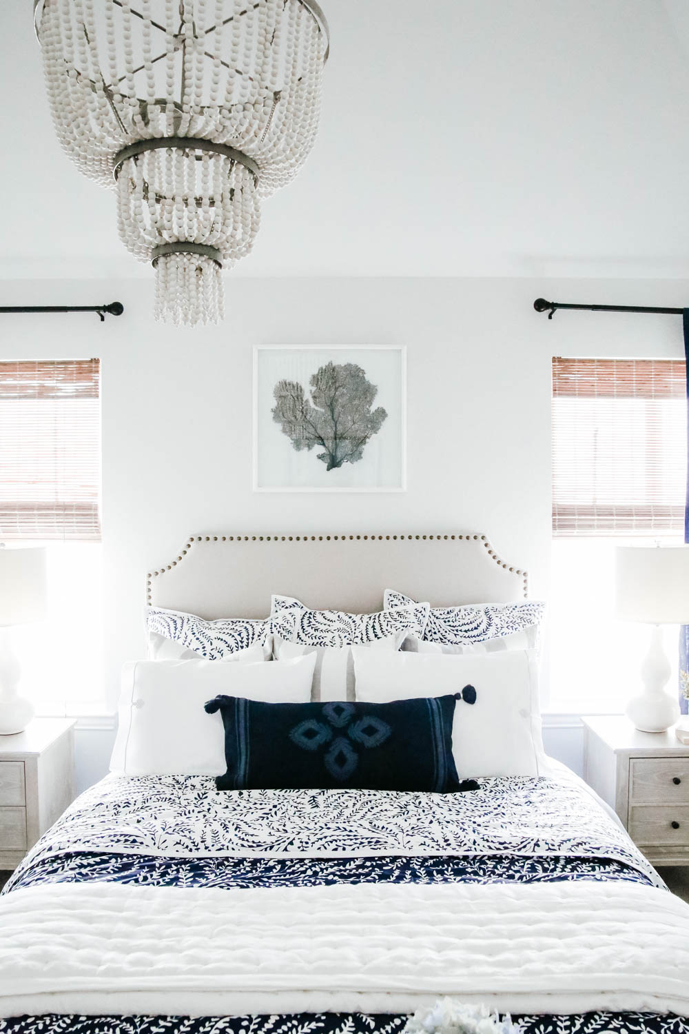 Use layers of bedding to create a cozy guest room. #ABlissfulNest #guestroom #guestbedroom
