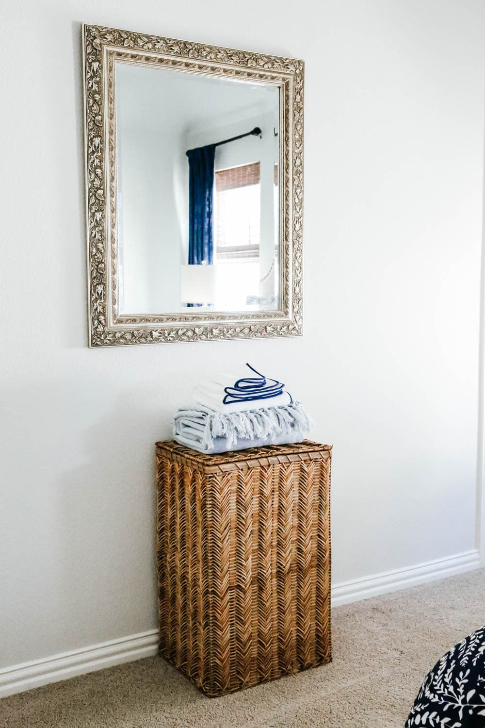 Provide a place for your guests to put dirty laundry. #ABlissfulNest #guestroom #bedroomdecor