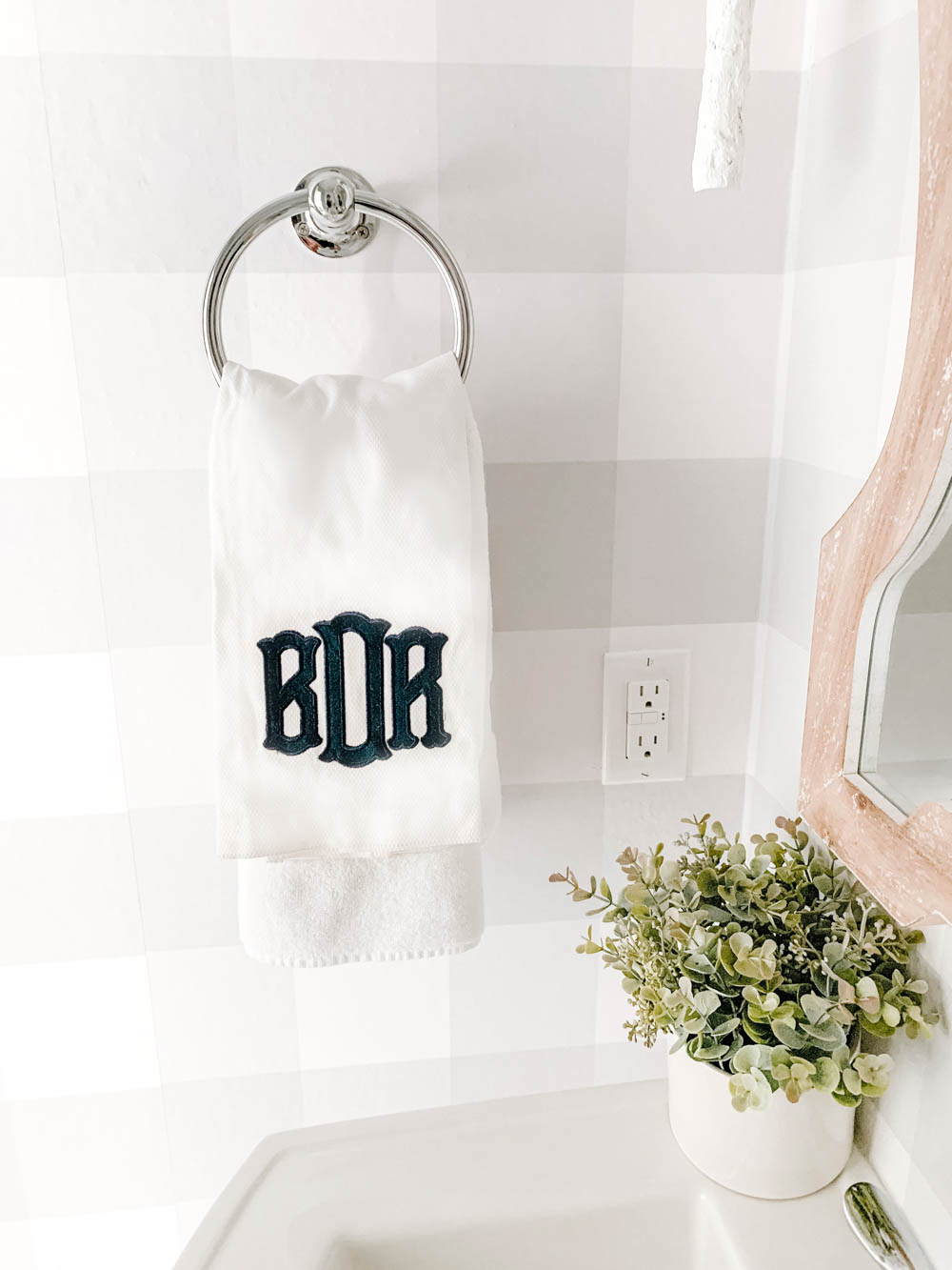 Navy blue and white monogrammed towel personalizes a beautiful powder bathroom. #ABlissfulNest #bathroommakeover #bathroom #bathroomdecor #farmhouse