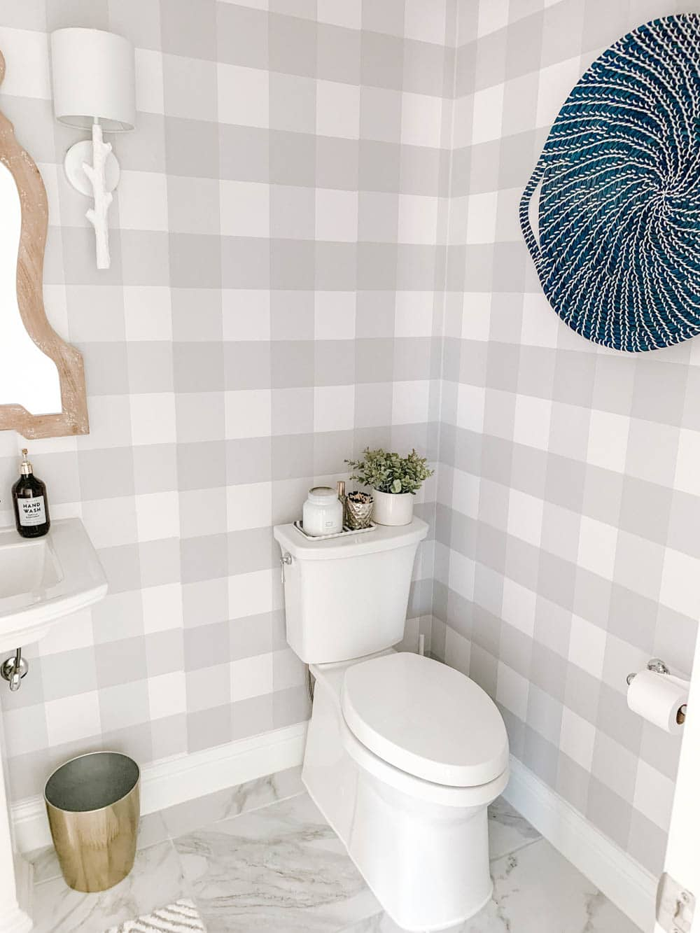 Clean white accents and grey and white buffalo check wallpaper. #ABlissfulNest #bathroomdesign #bathroom
