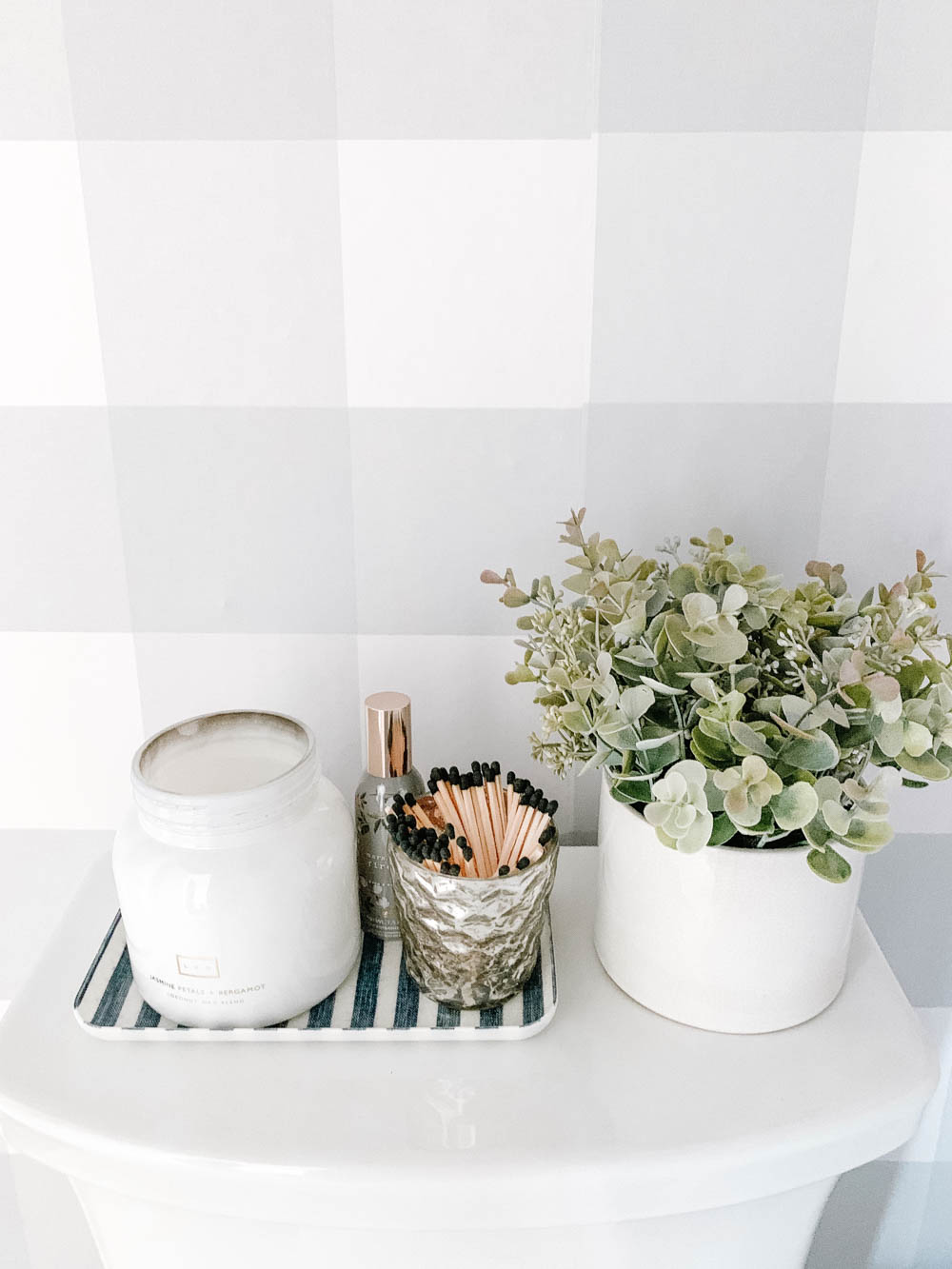 Pretty little bathroom details like a scented candle, matches in a mercury glass jar and a potted plant. #ABlissfulNest #bathroom #bathroomdesign