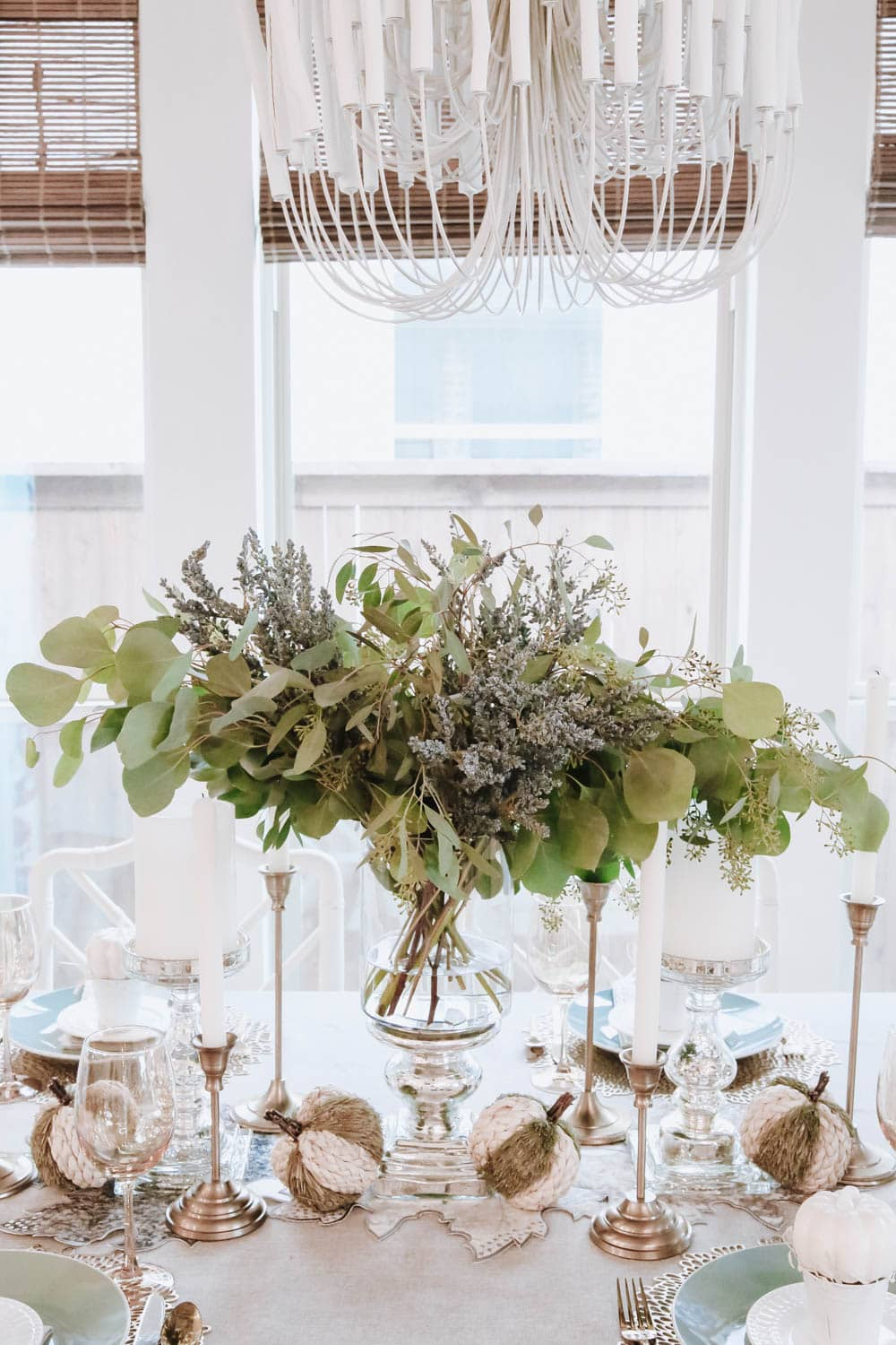 Simple seeded eucalyptus branches in a silver hurricane is beautiful and elegant for this fall table. #ABlissfulNest #thanksgiving #falldecor