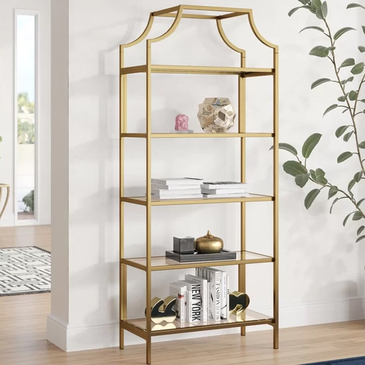This gold bookcase is on sale and a perfect piece to add to any room in your home! #ABlissfulNest