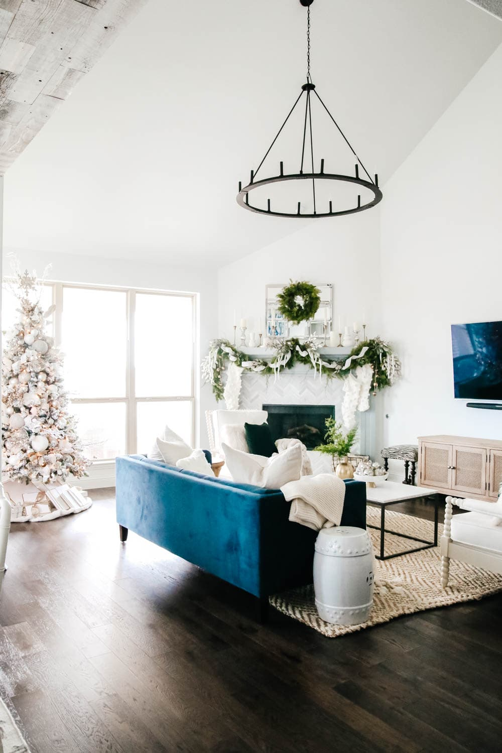 Green accent and soft subtle Christmas decor in a blue and white living room. #ABlissfulNest #christmasdecor #christmashometour