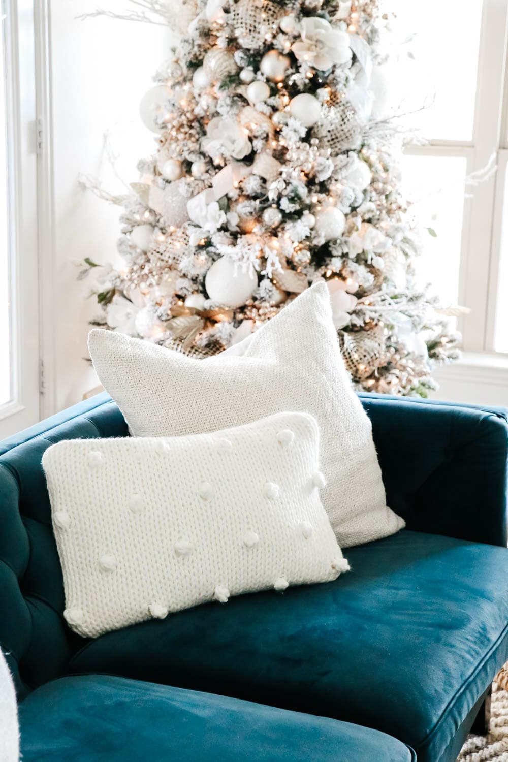 Beautiful pom pom pillow and neutral Christmas tree paired with this blue velvet sofa for the holidays. #ABlissfulNest #christmasdecorating #christmasdecorideas