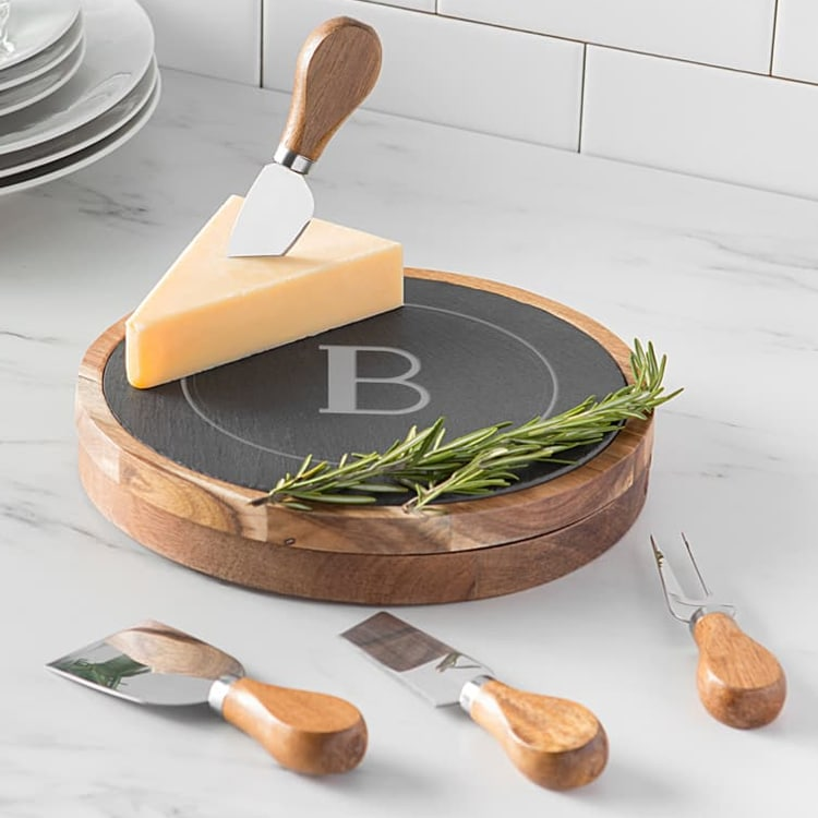 This monogrammed cheese board is perfect for NYE entertaining! #ABlissfulNest