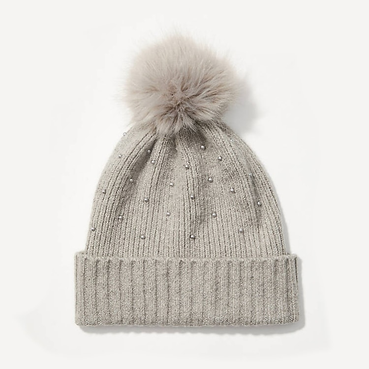 This pearlized pom pom beanie is so cute for a cold, winter day! #ABlissfulNest