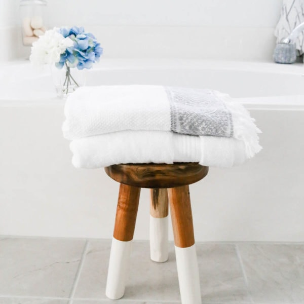 Add fresh towels and layer with different patterns in a bathroom refresh. #AtHomeStores #AtHomeFinds #ad