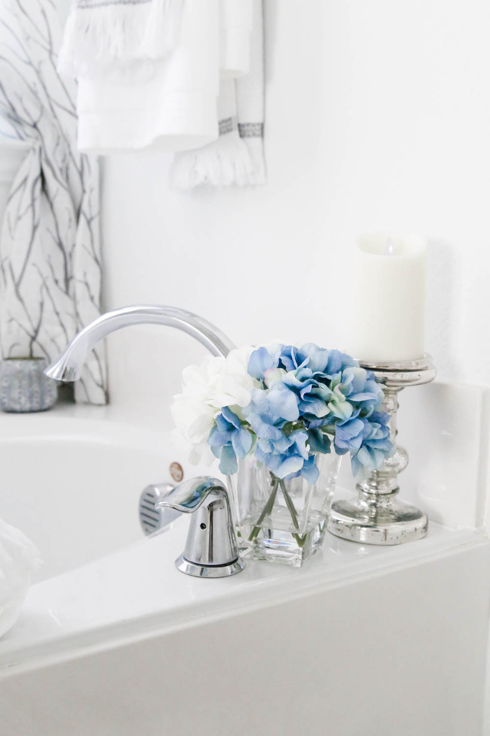 Create ambience with flowers and candles. #AtHomeStores #AtHomeFinds #ABlissfulNest #ad