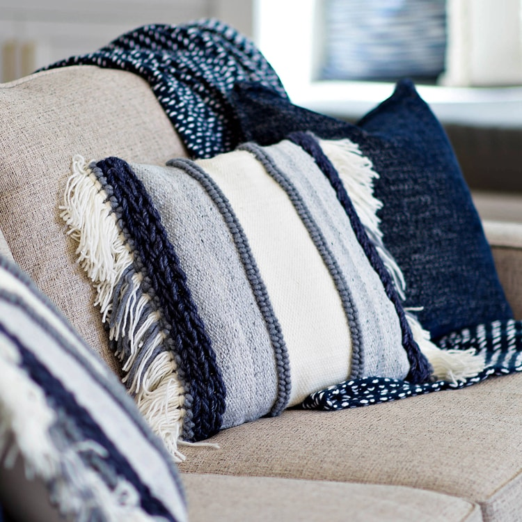 This beautiful blue textured throw pillow is the perfect addition to your winter living room decor and is perfect for year-round use too. #ABlissfulNest