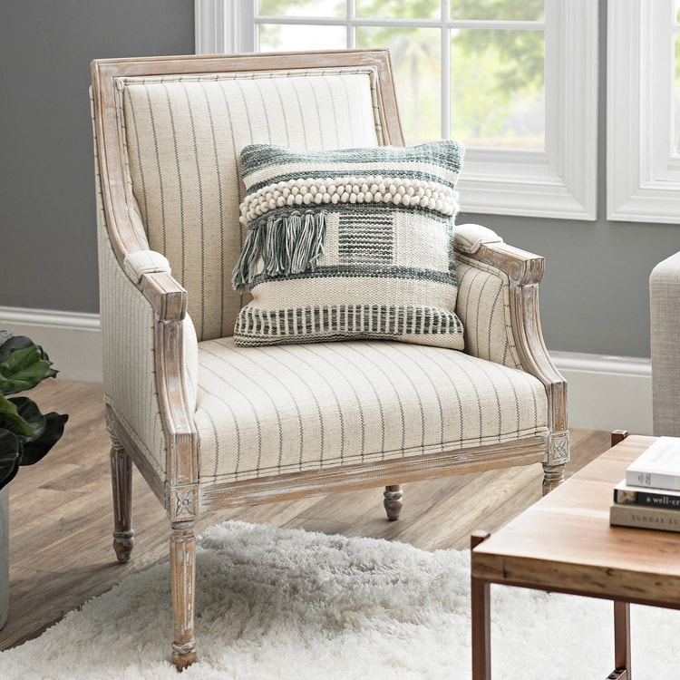 This striped accent chair is the perfect way to spruce up your living room! #ABlissfulNest