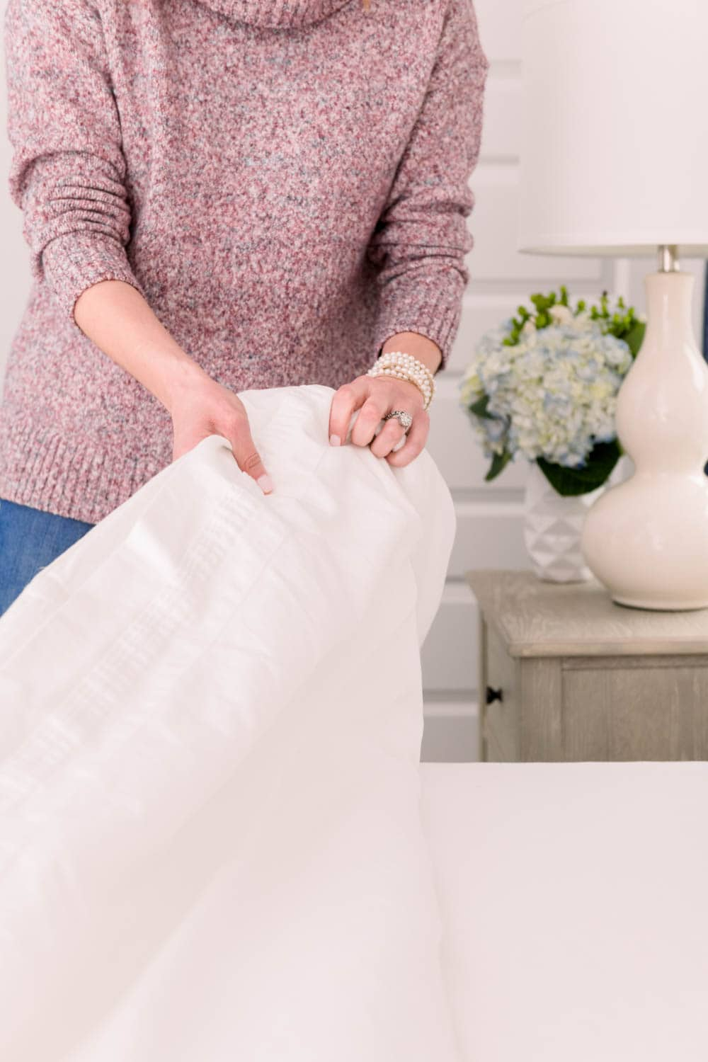 Crisp sheets make all the difference when making a cozy warm bed. #ABlissfulNest #bedding #beddingideas