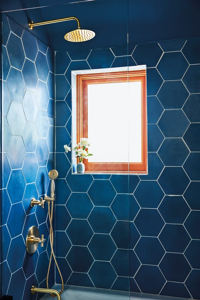 shower with blue tile and clean window
