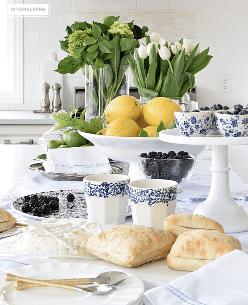 accessories being used to showcase 2020 paint trends in a kitchen such as blue and white china