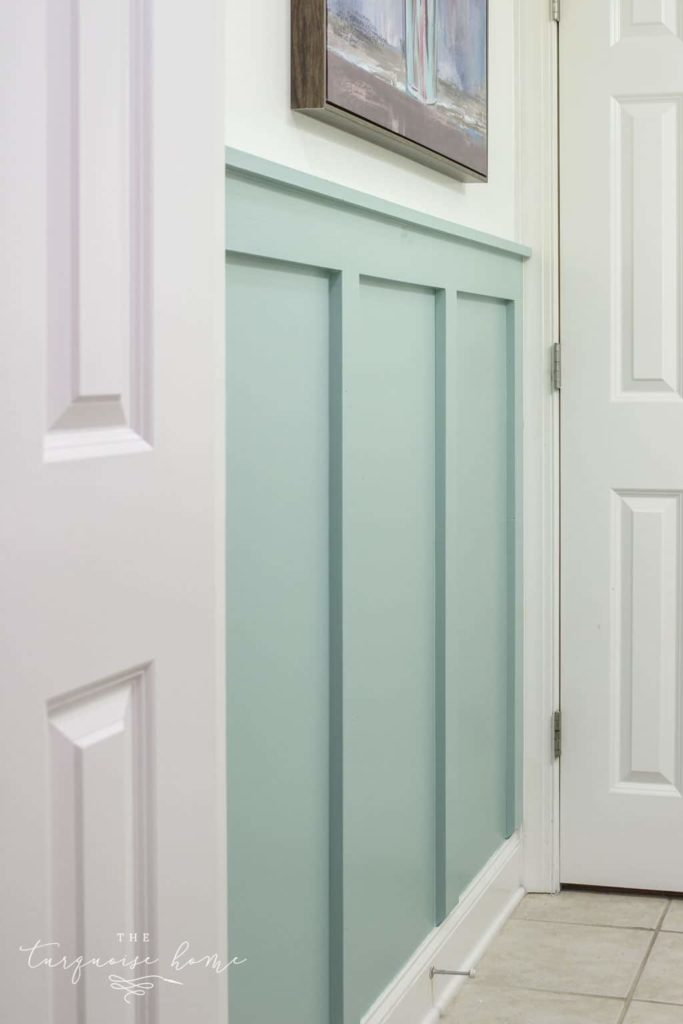 DIY board and batten painted in a trendy mint color