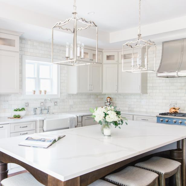 Kitchen with shiny white quartz countertops.