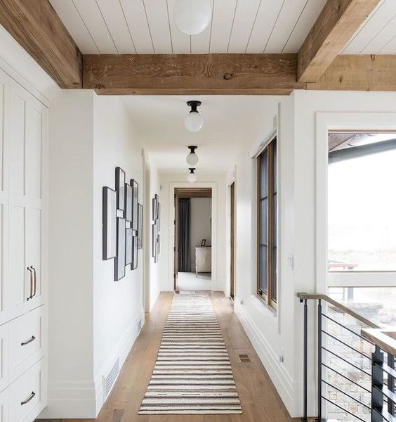 Beautiful flush mount fixtures in this hallway by Studio Mcgee.