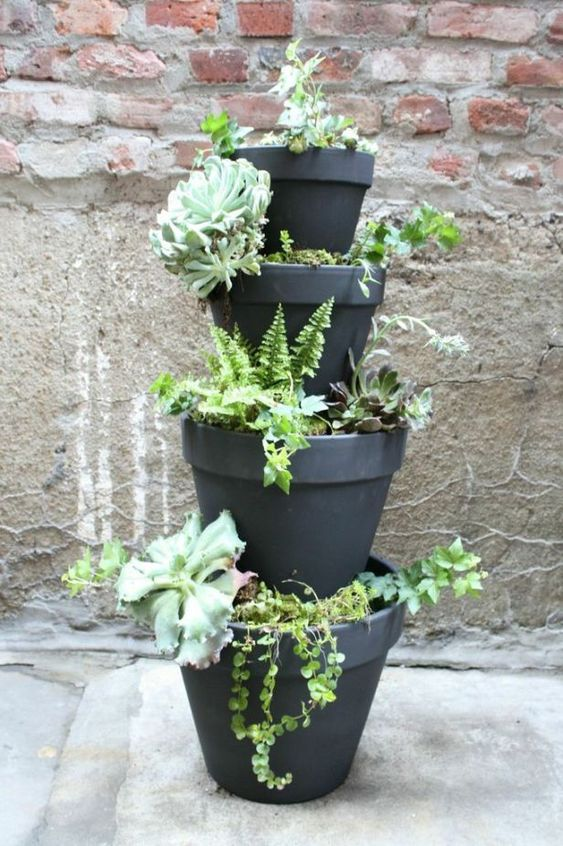 stacked planters are a whimsical and fun idea for a front porch