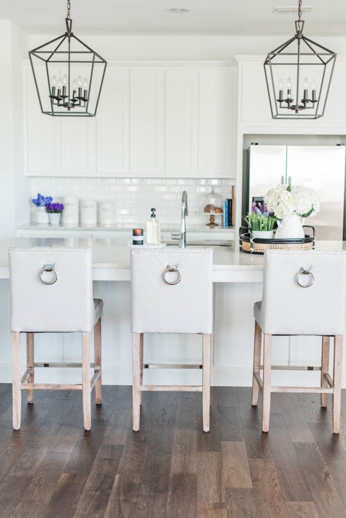 All white kitchen with white barstools