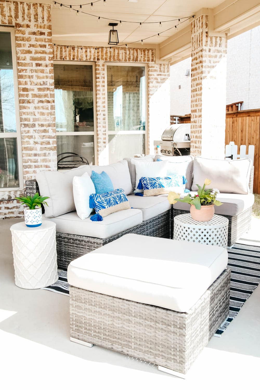 Comfortable seating, throw pillows in beautiful blue. #ABlissfulNest #patio #outdoor #backyard
