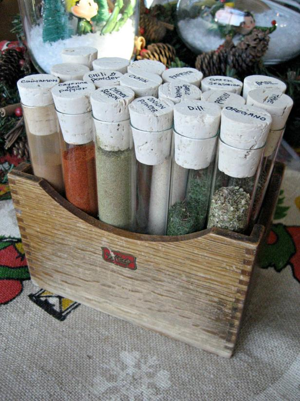 test tube spice storage in a vintage wooden crate