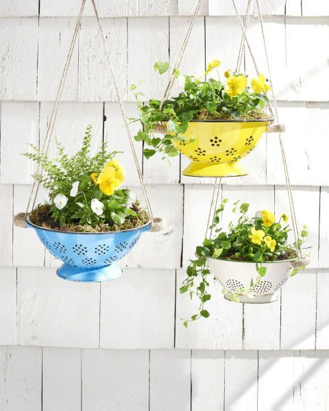 repurposed colanders used as planters