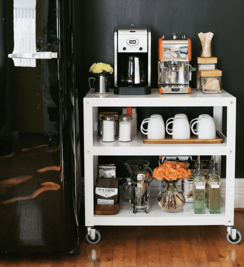 home coffee bar on wheels against a black painted wall