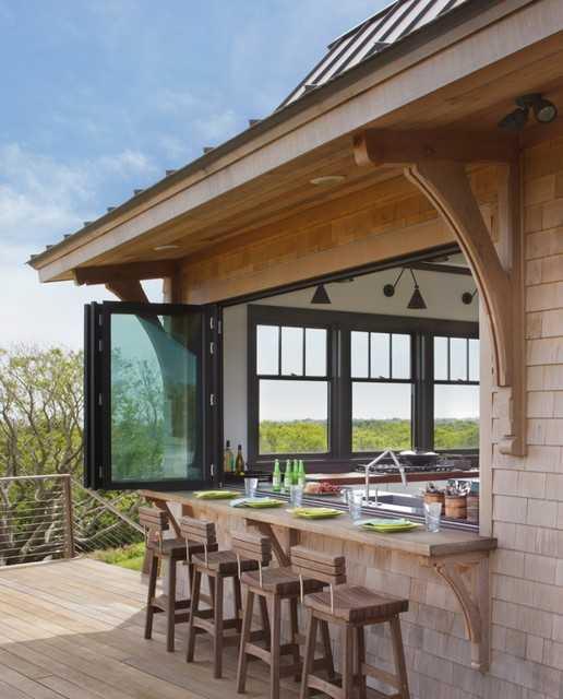 sliding windows create an outdoor bar area