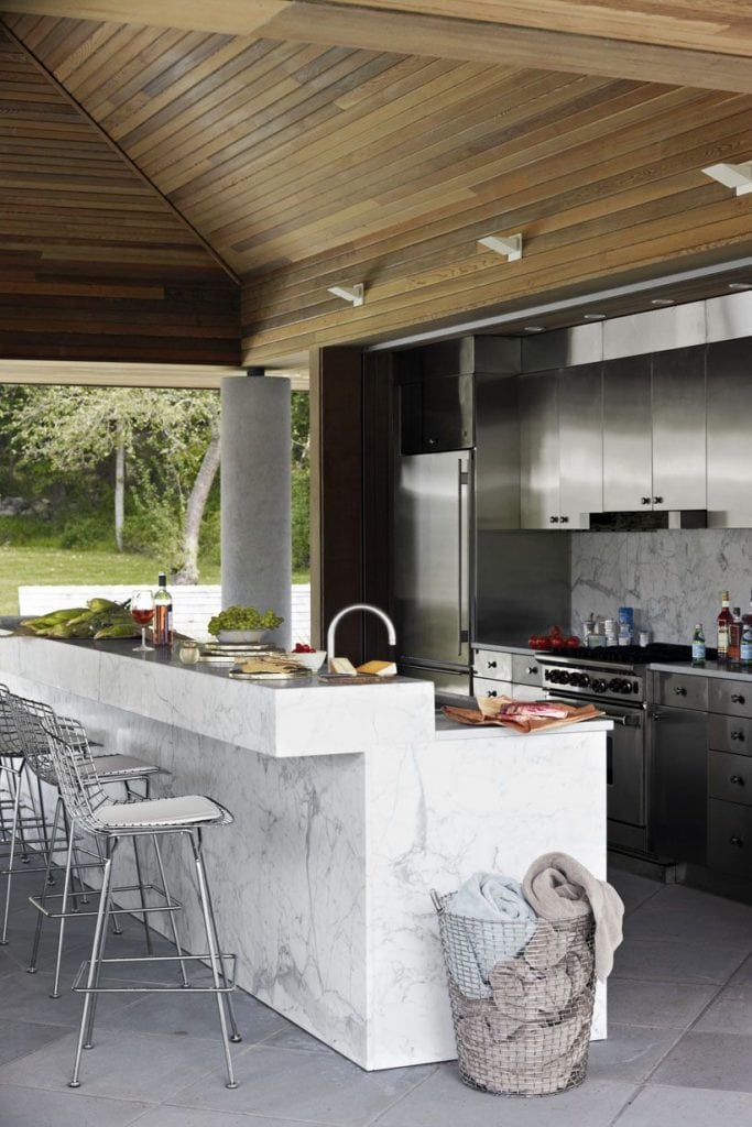stained oak and marble outdoor kitchen bar