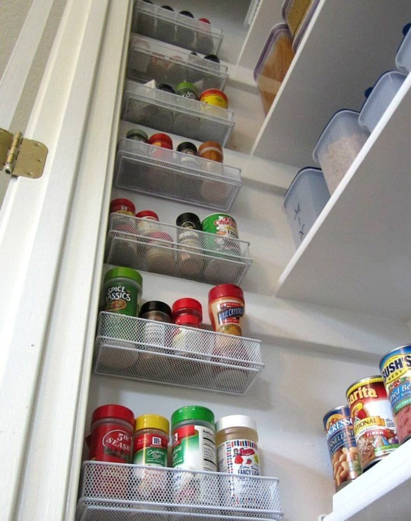 drawer organizers hang on the wall inside pantry for spice storage