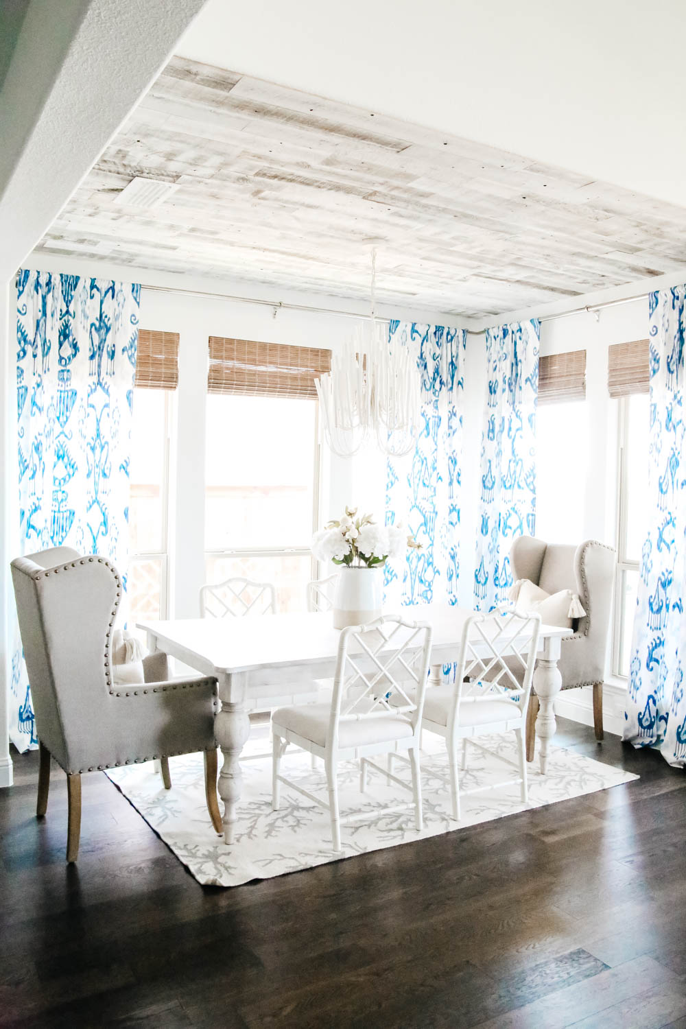Blue and white dining room with bamboo shades. #diningroom #breakfastroom #ABlissfulNest