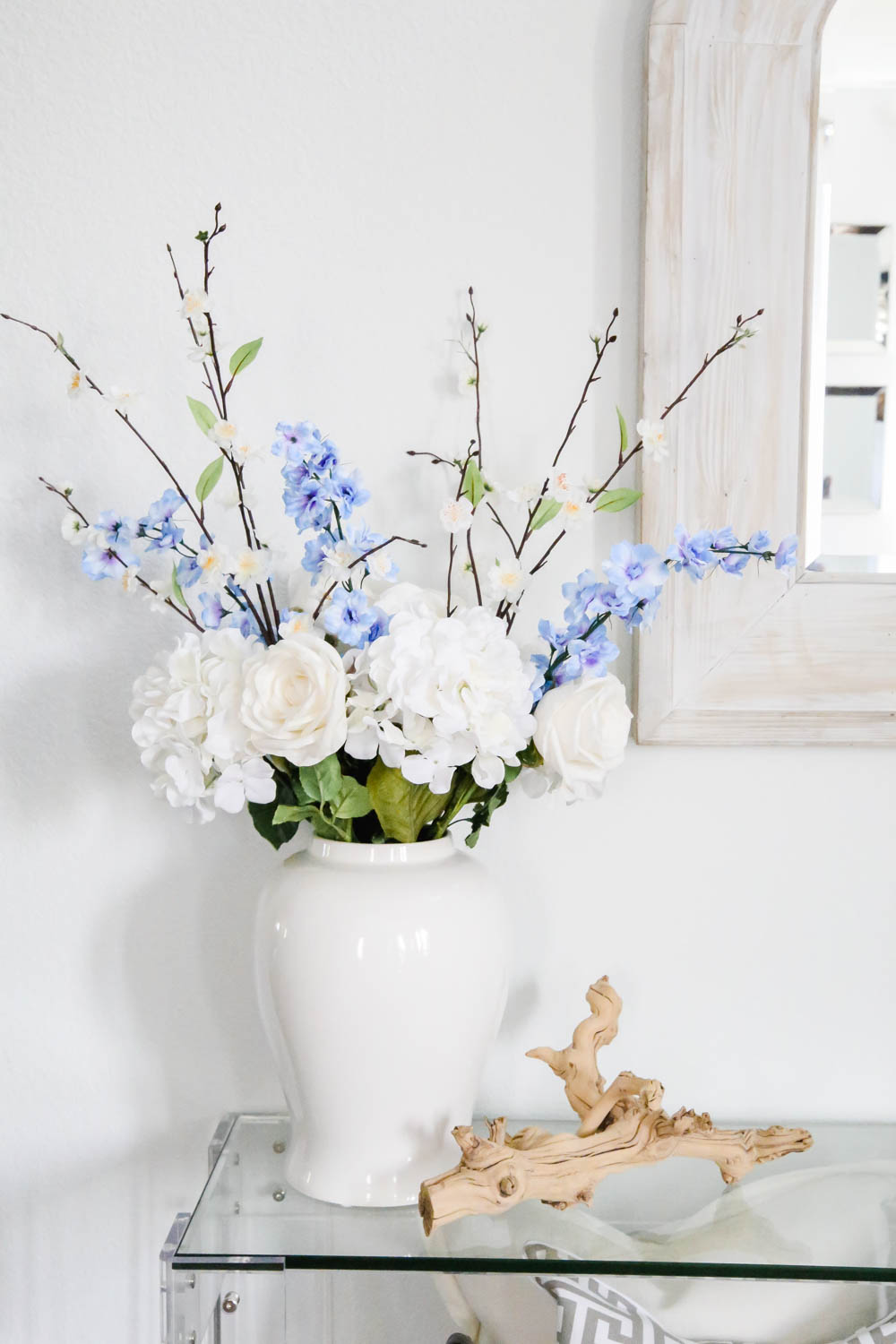 Beautiful spring floral arrangement in white vase, simple branch decor, spring decorating ideas. #ABlissfulNest #springdecor #springideas