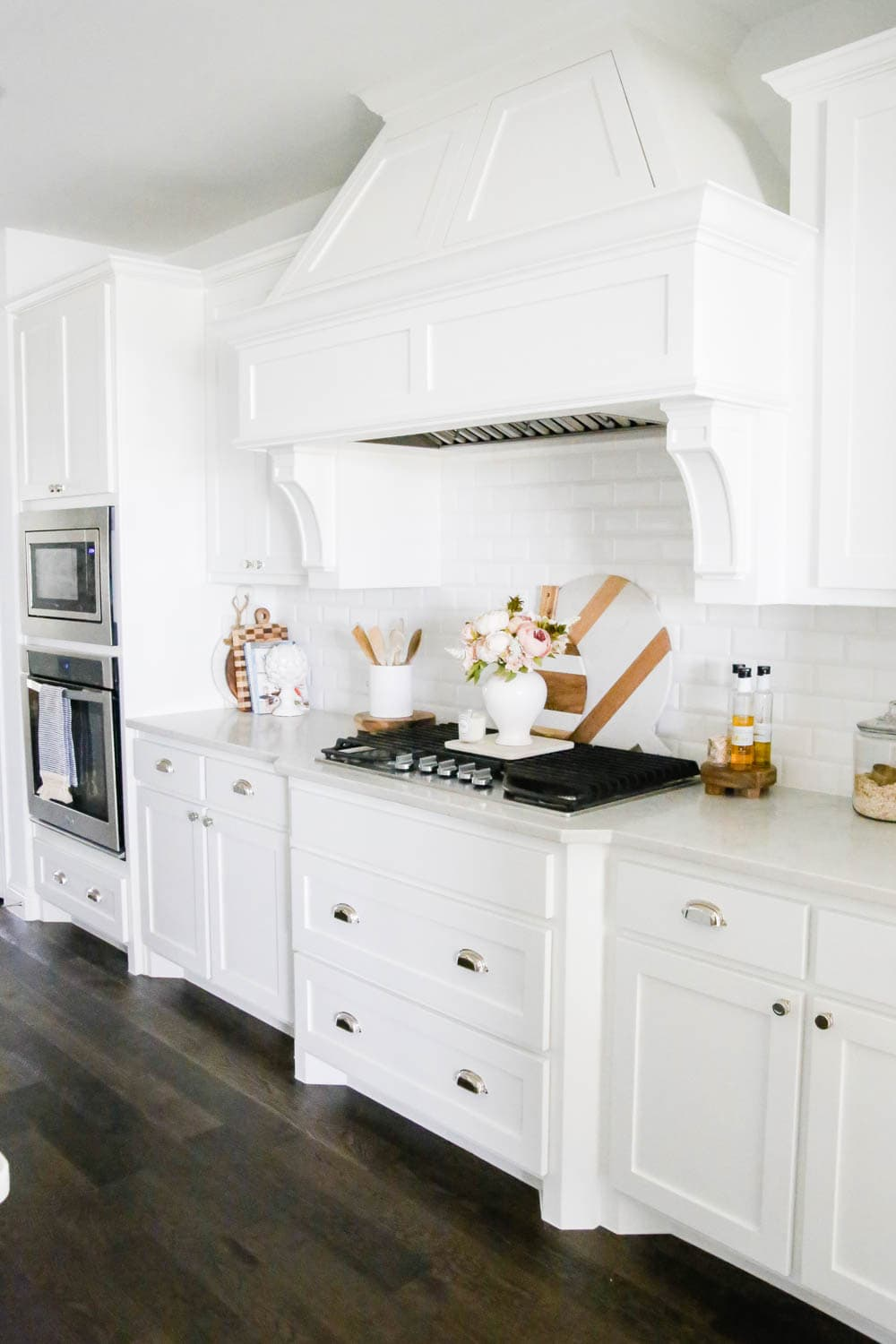 White kitchen with marble and wood cutting boards. #whitekitchen #kitcheninspo #kitchendecor #ABlissfulNest