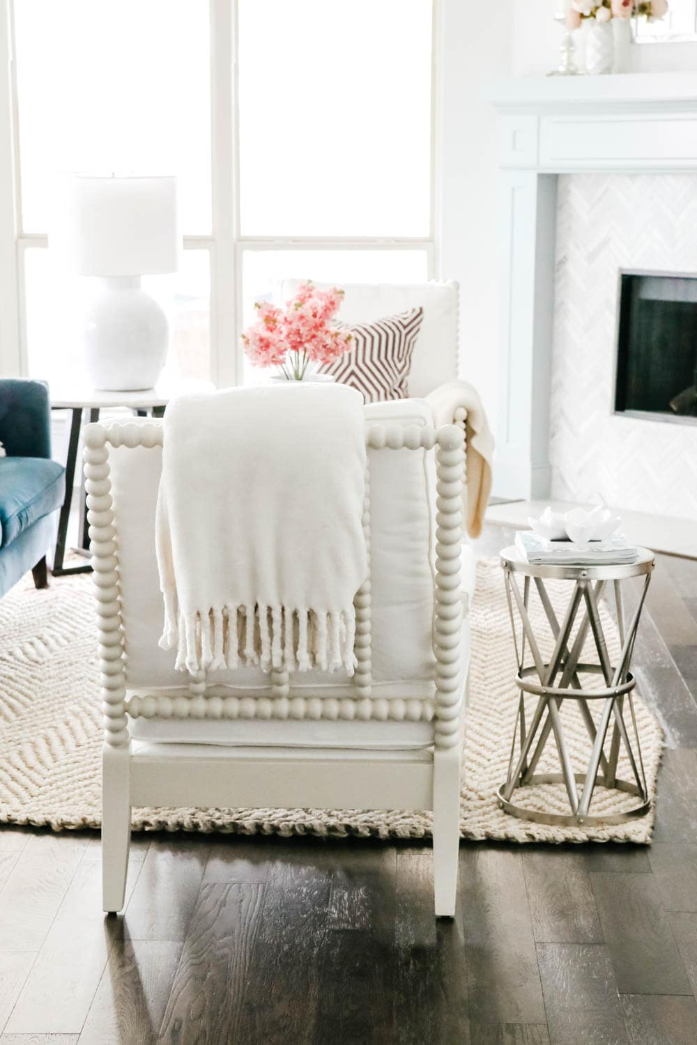 White spindle chair in coastal style living room. #livingroom #livingroominspo #hometour #ABlissfulNest
