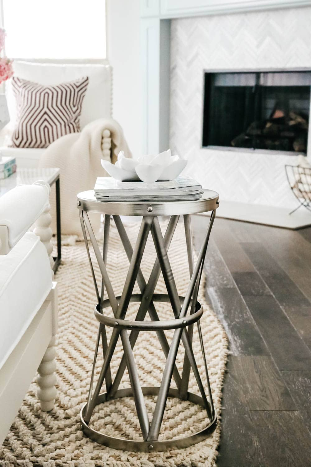 Metal side table with modern flower art. Living room inspiration. #livingroom #livingroominspo #hometour #ABlissfulNest
