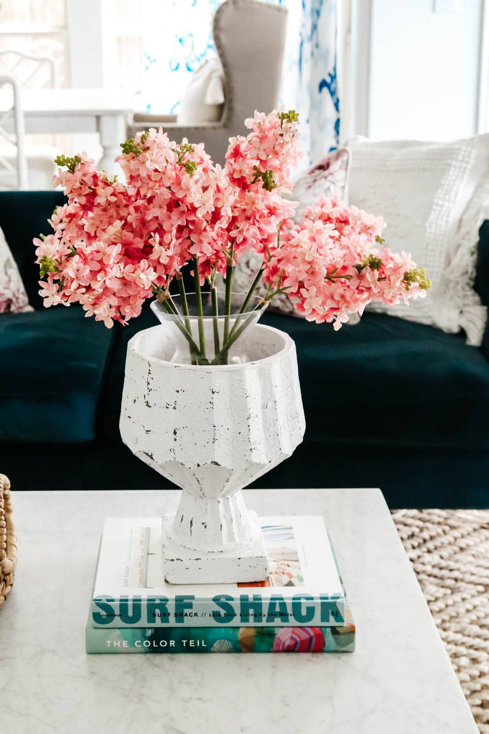 Spring flowers, home decor coffee table books, navy sofa, living room inspiration. #livingroominspo #hometour #fauxflorals #ABlissfulNest