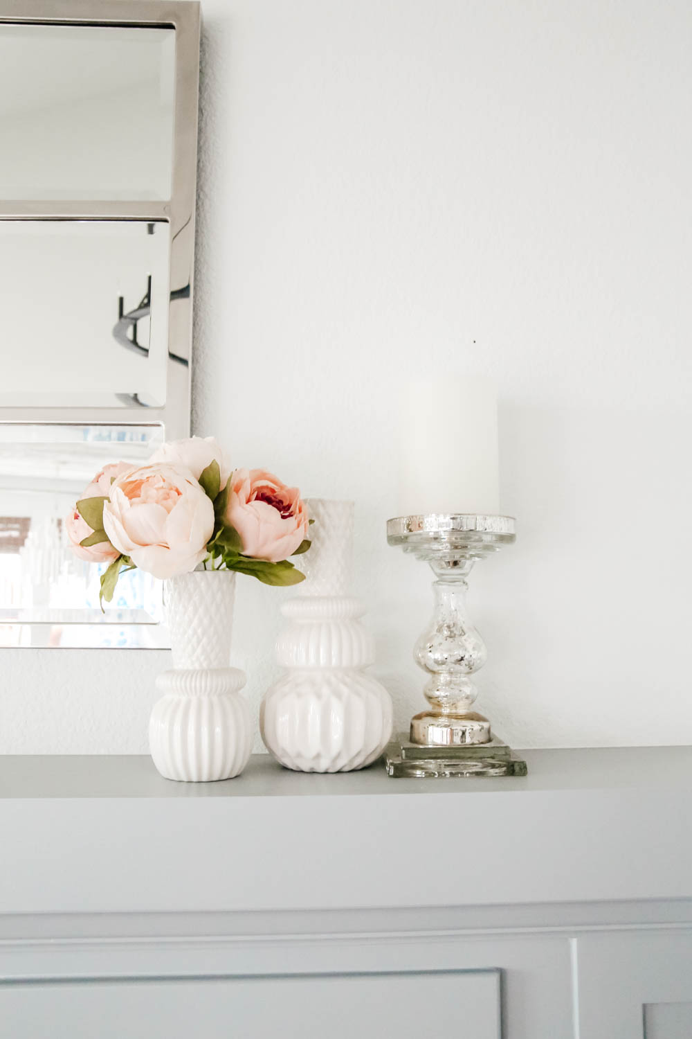Fireplace decor details. White vases, mercury glass candlestick, peonies flowers. #livingroominspo #hometour #springdecor #ABlissfulNest