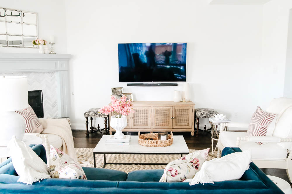 Tv wall with navy blue sofa and white walls. #hometour #designtips #livingroominspo #livingroom #ABlissfulNest