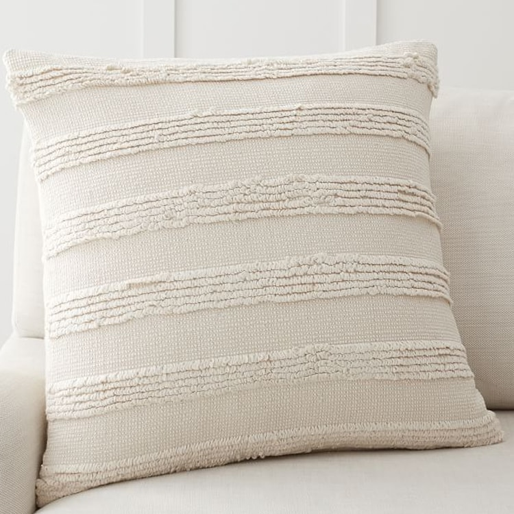 A pretty, neutral throw pillow to add to your spring decor! #ABlissfulNest