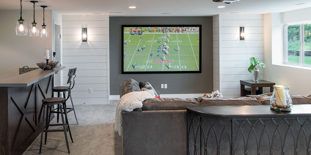 Create a feature wall and multiple seating areas for your home media room. #mediaroom #theaterroom
