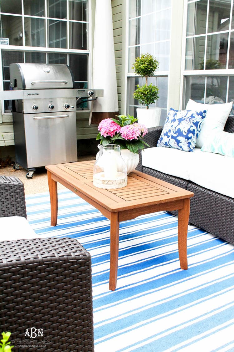 Decorate an outdoor space with these affordable decor finds and tips. #ABlissfulNest #patio #outdoordecor