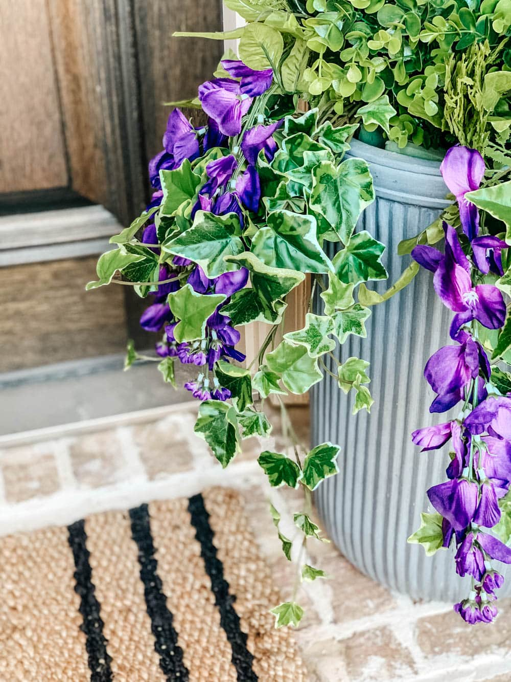 Tutorial on how to arrange and use artificial flowers and plants in outdoor planters. #ABlissfulNest #gardening #outdoorplanters
