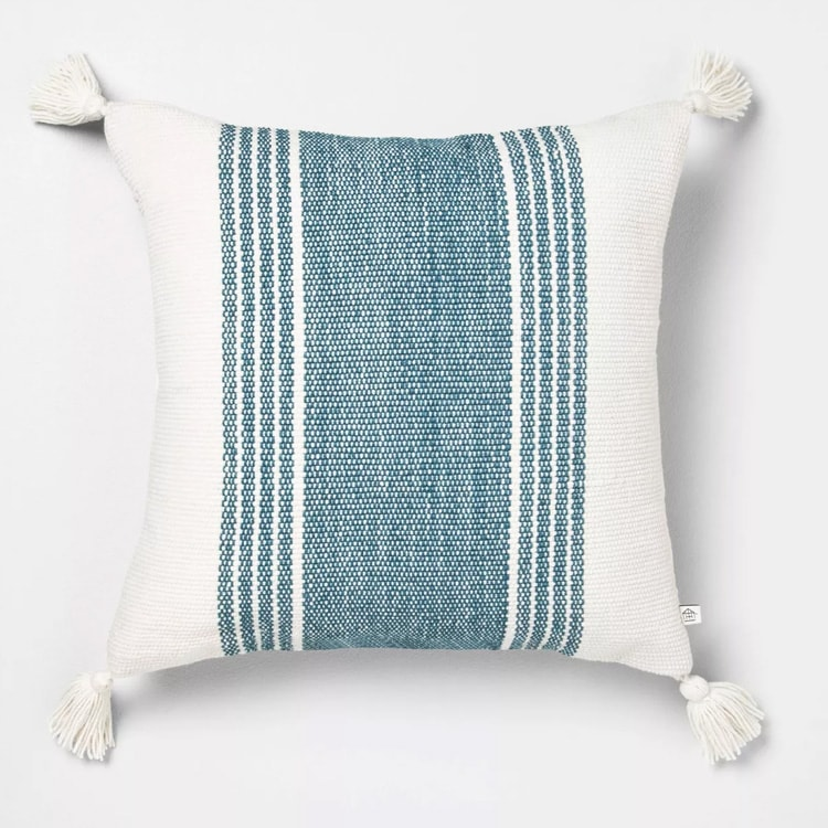 This striped throw pillow is the pop of color your outdoor space needs this summer! #ABlissfulNest